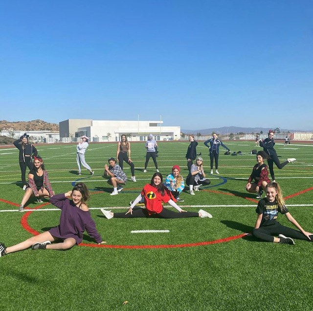 Dance team posing  on the field at practice on October 27th.